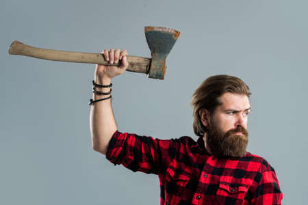 male hairdresser or barbershop. brutal butcher in shirt. lumberjack ready to work in forest. confident brutality of woodman.