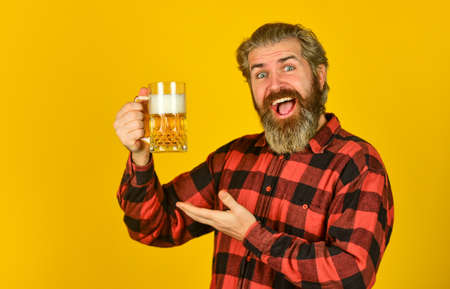Alcohol addiction. relaxed handsome man sipping delicious beer. enjoying glass of beer at pub. anticipating fresh cold lager beer. after hard working day. drink draft beer at bar counter in pub