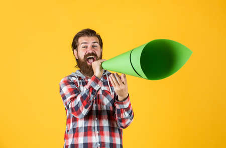 Human rights. ads for everyone. Promotion and information expansion to masses. mass media concept. make voice louder. bearded man shout in megaphone. man with paper loudspeaker. freedom of speech Stock Photo