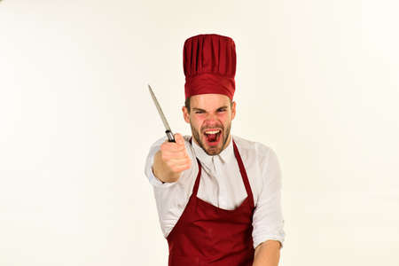Cook works in kitchen. Chef with mad yelling face