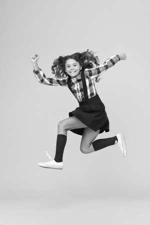 Happy child in midair background.