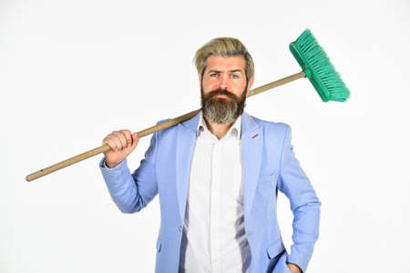 Staff reductions concept. Business cost reduction. Where start cleaning. Clear reputation. Hipster hold cleaning tool. Man use broom. Businessman sweeping office. Unemployment and business reduction