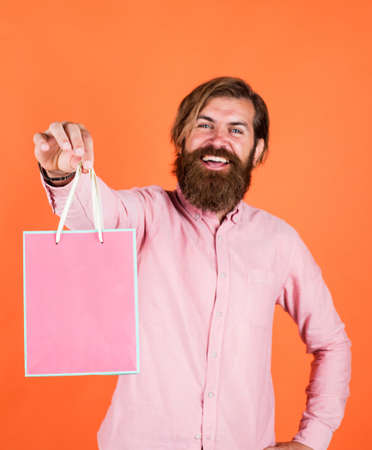 crazy about shopping. bearded man gift holiday decoration. businessman holding gift pack. gift to colleague at work. surprised man unpacking. the package delivery. human emotion and facial expression