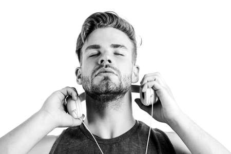 man wearing headphones. ebook and online education. music education. sexy muscular man listen ebook. man in earphones isolated on white. e book. unshaven man study inline Фото со стока