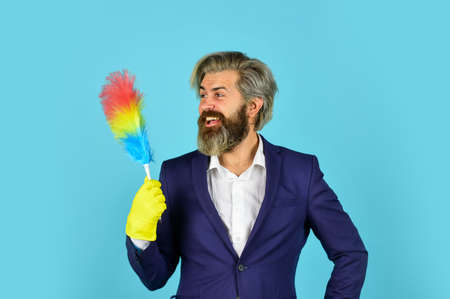 Businessman cleaning office. Clear reputation. Hipster hold cleaning tool. Cleaning concept. Office duster. Cleaning service. Housekeeping duties. Cleaning apartment. Man use pp duster. Dust allergy