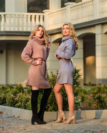 Emphasize waist with strap belt. Knitwear concept. Vogue models. Cashmere woolen sweaters. Warm oversized sweaters. Women wear sweaters. Elongated sweatshirts tunics or dress. Girls in fall outfits