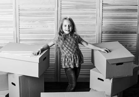 finally. happy child cardboard box. purchase of new habitation. Cardboard boxes - moving to a new house. repair of room. new apartment. unpacking moving boxes. happy little girl sit in room on boxes Banque d'images