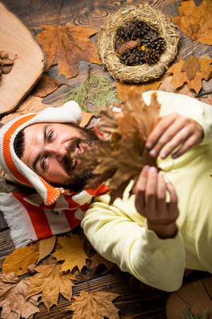 I would stay here forever. Excited happy fall male. bearded man enjoy life and freedom. season of shopping sale. Autumn leaves in hands. playing in autumn nature. happy hipster on fall background