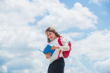 Back to school. Little child going to school. Knowledge day. Outdoors classes. Successful schoolgirl. Your chance for successful future. Free education. Happy girl with school backpack sky background Banque d'images