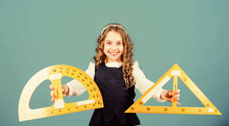 math lesson. Education and knowledge. STEM school disciplines. School student learning geometry. small girl back to school. Pupil girl with big rulers. You are so smart