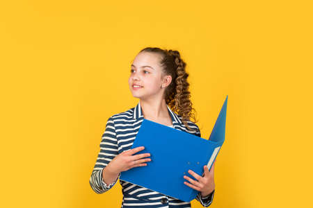 Administrative. Coordinator and project management. Library assistant. Student teen formal style. Education concept. Happy girl hold library folder. School library. Knowledge and information