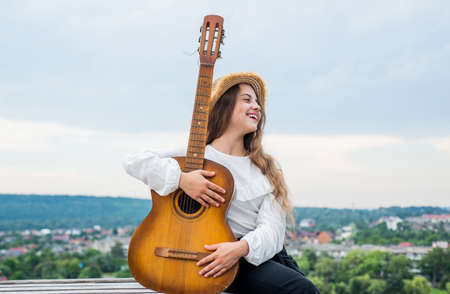sound of the streets. talented girl musician. Lifestyle and People Concept. playing the guitar. play on string instrument. having a party. Happy kid with acoustic guitar. music concept. Singing Songs