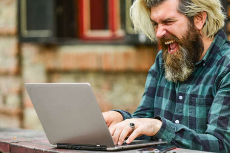 go shopping on cyber monday. happy bearded man in cafe with laptop. online distant education. hipster inspired to work. agile business. mature student working on computer. Failed again
