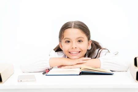 Lost in fairytale. kid learning grammar. back to school. dictionary notebook. Get information. happy girl with workbook. Education. small girl in school uniform. reading story. childrens literature