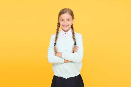 Schoolgirl happy smiling pupil long hair. Beginning of academic year. Educational activity. Homeschooling or visiting regular school. Efficiency of studying. Adorable schoolgirl. Diligent schoolgirl Standard-Bild