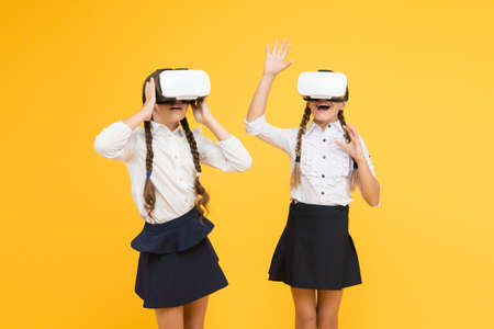 Enjoy new experience. Happy kids use modern technology. future education. back to school. Digital future and innovation. virtual reality. small girls in VR headset. children wear wireless VR glasses