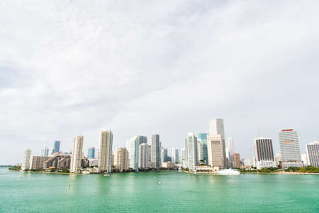 Miami has an Atlantic Ocean waterfront lined with marinas. Downtown Miami is urban city center based around Central Business District of Miami. Skyscrapers and azure ocean water. Must see attractions Stock fotó - 154430261
