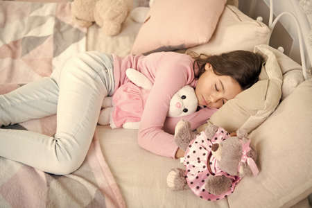 small girl sleeping at home. christmas family holiday. happy new year. Christmas shopping. waiting for santa. We love Christmas. The morning before Xmas. Sleep. little child girl with xmas present Stock fotó