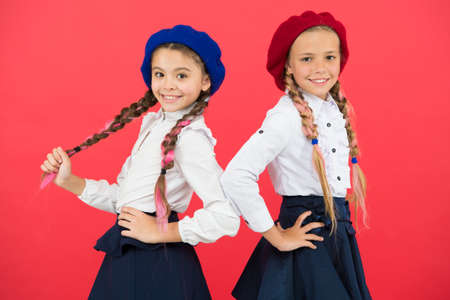 On same wave. Schoolgirls wear formal school uniform. Children beautiful girls long braided hair. Little girls with braids ready for school. School fashion concept. Fancy style. School friendship