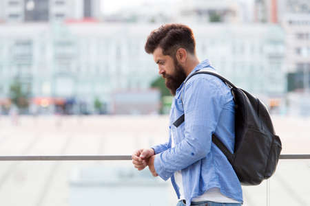 Tourist handsome thoughtful hipster backpack. Man with beard and rucksack explore city. Travelling concept. Tourist on vacation. Hipster modern tourist urban background. Looking for adventures