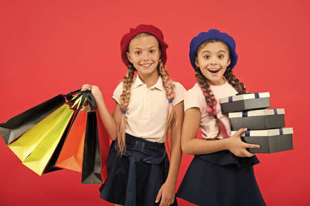 big sale in shopping mall. small girl children with shopping bags. Birthday and christmas presents. Happy shopping online. International childrens day. friendship and sisterhood. Online shop