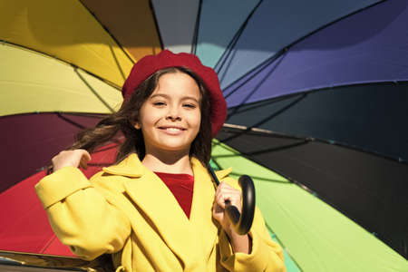 Colorful fall accessory positive influence. Ways brighten your fall mood. Girl child long hair ready meet fall weather with umbrella. Colorful accessory for cheerful mood. Stay positive fall season