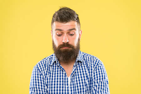 Beard as distinctive as you are. Brutal caucasian guy with beard on yellow background. Unshaven hipster with textured beard hair. Bearded man with stylish mustache and beard shape