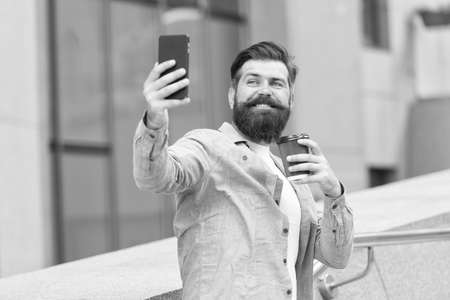 Chatting and meeting with friends online. Bearded man chat online via cellphone. Online meeting. Audio or video conferencing on mobile device. Online video call. Smartphone communication Imagens