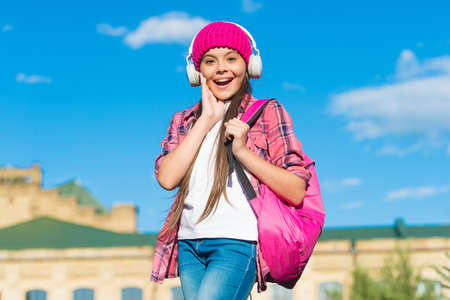 Keep calm and listen on. Happy kid listen to music sunny outdoors. Learning language. Listening comprehension skills. English school. Musical education. Courses available on audio