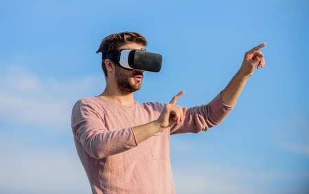 macho man wear wireless VR glasses.. New word of virtual reality. Digital future and innovation. guy virtual reality goggles. man sky background vr glasses. male reality. Use vr headset Foto de archivo