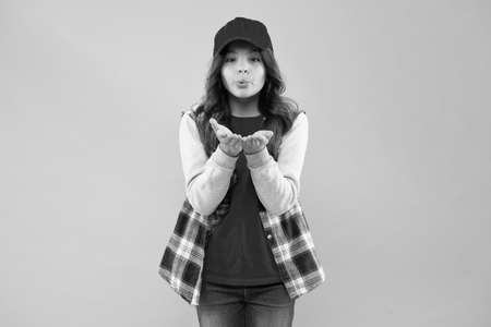Let your look speak for itself. Small child blow kiss pink background. Beauty look of little girl. Adorable kid in hipster style. Vogue look. Fashion and beauty. Casual but cute look. Streetwear
