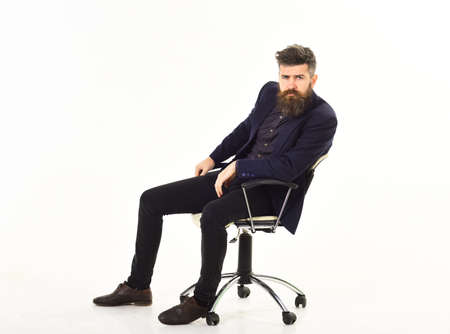 Sad emotions concept Man sits in office chair with miserable sad face.