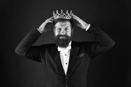 Royal duty suggests. Handsome king. Man representing power and triumph. Business king. Businessman wear crown. Success in business. Achieving victory and success. Royal and luxury. Winner concept