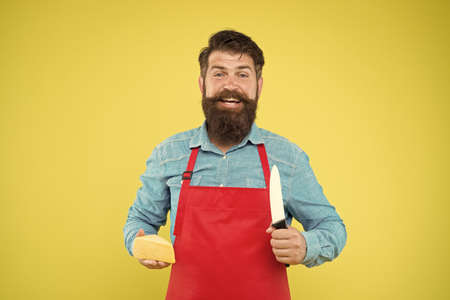 lets make sandwich. cheese maker own business. hipster with beard in chef apron. Dairy food shop. cheese festival. Diet and nutrition. happy bearded man cut cheese with knife. cheesemaking concept