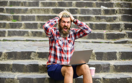 When deadline coming. Fresh air. Mobile internet. Agile business. Work and relax. Working online. Hipster inspired work in urban space. Modern laptop. Remote job. Bearded guy sit stairs background