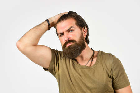 Brutal bearded hipster. Handsome man. Barbershop salon. Care for male skin. For oily skin suffering from frequent shaving choose anti inflammatory and soothing ingredients. Beauty and hair fashion 写真素材