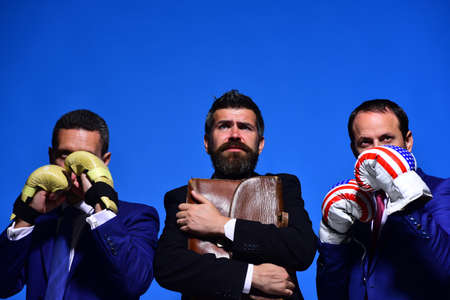 Company fights for business leadership. Bosses wear boxing gloves,