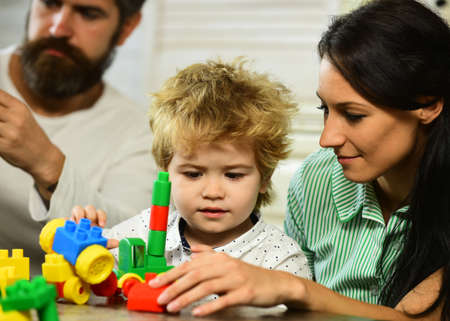 Family and childhood concept. Parents and son with busy faces Stock fotó