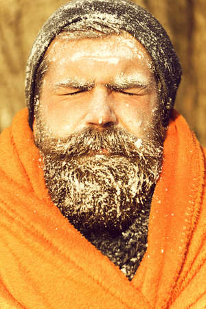 Frozen man in orange blanket