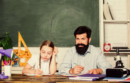 Wisdom. daughter study with father. Teachers day. back to school. knowledge day. Home schooling. education child development. bearded man teacher with small girl in classroom