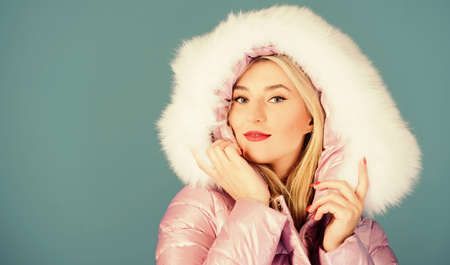 seducing you. happy winter holidays. Xmas coming. beauty in winter clothing. cold season shopping. girl in hood. faux fur fashion. flu and cold. seasonal fashion. woman in padded warm coat