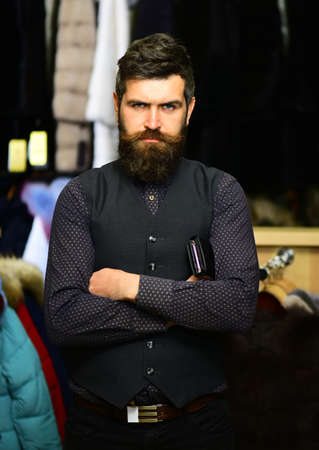 Businessman with cash and expensive overcoats. Customer with beard
