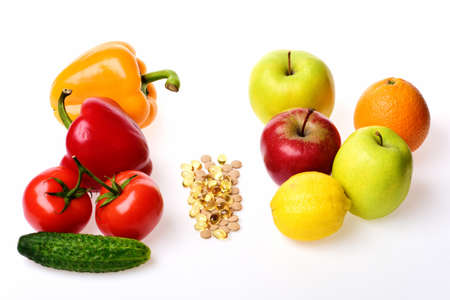 Omega 3 capsules, apples, citruses and vegetables.