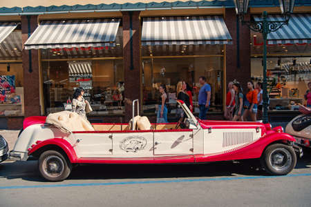 Prague, Czech Republic - June 03, 2017: vintage car cabrio replica parked at street. Sightseeing tour. Seeing city landmarks. Discovery and adventure. Touring and traveling. Day trip Sajtókép