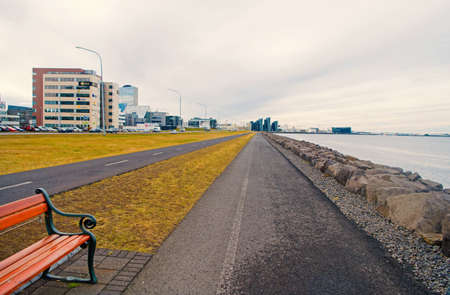 Reykjavik, Iceland - October 12, 2017: coastal landscape. Cross country traveling. Sea promenade roads on natural landscape. Enjoy traveling along sea side. Happiness is traveling Stock fotó - 154422867