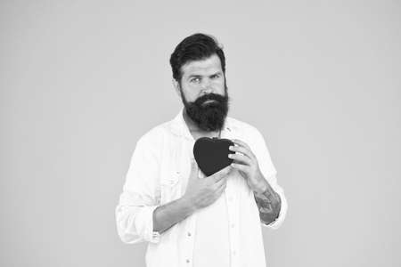 Be patient. happy valentines day. heart poblems and disease. preventing heart attack. fall in love. love and romance. being human organ donor. bearded man red heart. brutal hipster yellow background