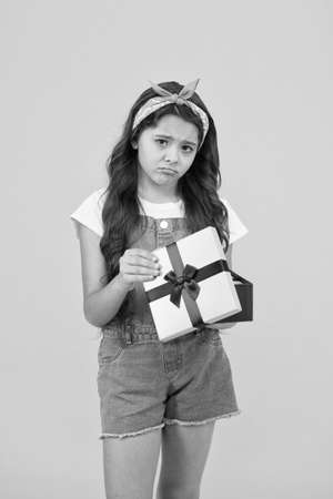 Disappointment concept. Not what I wanted. Kid love birthday gift. Feeling sad bad gift. Surprise present box. Kid girl disappointed gift. Unexpected surprise. Celebrate birthday. Crushed dream