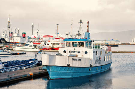 Reykjavik, Iceland - October 14, 2017: touristic ship in sea harbour. Travelling by ship. A better way of travelling. Touristic operator that makes leisure time enjoyable