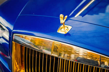 luxury Supercar rolls royce rolls-royce ghost blue and gold color parked on the street in Paris. rolls royce rolls-royce is famous expensive automobile brand car Stock fotó - 154424518