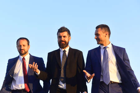 Business and success concept. Board of businessmen wear suits